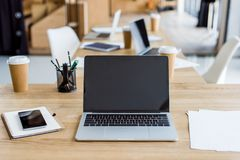 Laptops and smartphone on tables. In business office stock photos