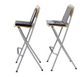 Laptops standing on bar high chairs Stock Photo