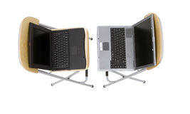 Laptops standing on bar high chairs Stock Images