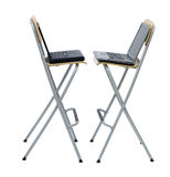 Laptops standing on bar high chairs Royalty Free Stock Photos