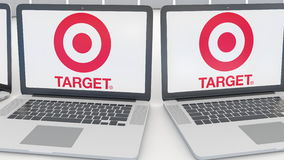 Laptops with Target Corporation logo on the screen. Computer technology conceptual editorial 4K clip, seamless loop. Laptops with Target Corporation logo on the stock footage