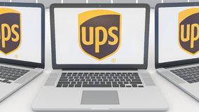 Laptops with United Parcel Service UPS logo on the screen. Computer technology conceptual editorial 3D rendering Royalty Free Stock Images