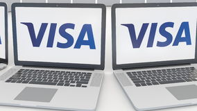 Laptops with Visa Inc. logo on the screen. Computer technology conceptual editorial 4K clip, seamless loop. Laptops with Visa Inc. logo on the screen. Computer stock footage