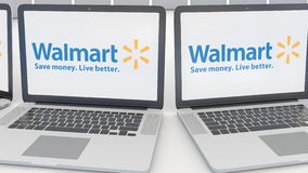 Laptops with Walmart logo on the screen. Computer technology conceptual editorial 4K clip, seamless loop. Laptops with Walmart logo on the screen. Computer stock video footage