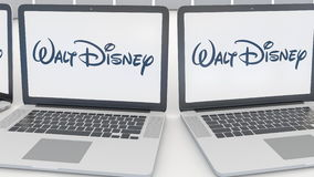 Laptops with Walt Disney Pictures logo on the screen. Computer technology conceptual editorial 4K clip, seamless loop. Laptops with Walt Disney Pictures logo on stock illustration