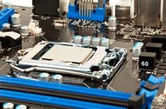 Laptopu czarny i błękitny macierzystej deski zbliżenie Obrazy Stock