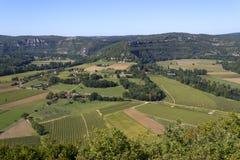 Lapwerkgebieden en landbouwbedrijven in de Partijvallei stock foto