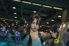 Lara Croft cosplayer posing at Games Week 2014 in Milan, Italy Royalty Free Stock Photography