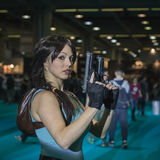 Lara Croft cosplayer posing at Games Week 2014 in Milan, Italy Stock Photos
