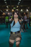 Lara Croft cosplayer posing at Games Week 2014 in Milan, Italy Royalty Free Stock Image