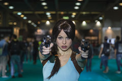 Lara Croft cosplayer posing at Games Week 2014 in Milan, Italy Royalty Free Stock Images