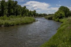 The Laramie River. Photograph of the Laramie River at Fort Laramie National Historic Site in Wyoming stock image