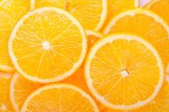 A laranja corta o fundo Imagem de Stock