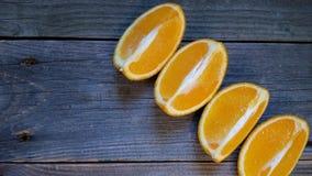 a laranja cortou o ‹do †do ‹do †em quatro porções Fotografia de Stock Royalty Free