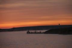 Laranja da água do nascer do sol Foto de Stock