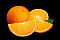 Laranja do fruto de Ctrus no preto fotos de stock royalty free