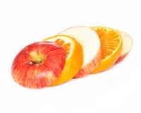 Laranja e maçã cortadas Fotografia de Stock Royalty Free