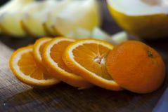 A laranja e o melão cortaram Fotos de Stock Royalty Free