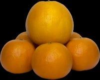 A laranja encontra-se em tangerinas Imagem de Stock