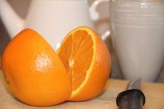 Laranja fresca para o café da manhã. Fotos de Stock