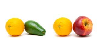 Laranja, maçã e abacate em um fundo branco imagem de stock royalty free