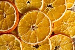 A laranja secada corta o fundo Imagens de Stock Royalty Free