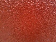Laranja vermelha parede texrured pintada, close up claro natutal imagem de stock