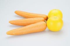 Laranjas e cenouras postas como a forquilha Foto de Stock Royalty Free