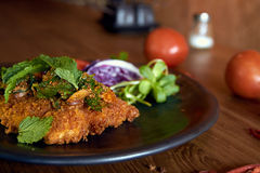Larb dolly. Isaan (Northeast of Thailand) style fried dolly fish with herbs and onions stock images