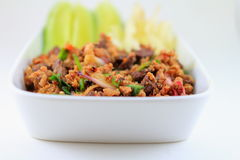 Larb. Is most often made with chicken, beef, duck, fish, pork or mushrooms, flavored with fish sauce, lime juice, roasted ground rice and fresh herbs stock images