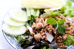 Larb pork. Minced pork cooked in Thai style. The taste is hot and spicy Royalty Free Stock Photo