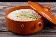 Lard. In a clay pot on a wooden table Stock Photography