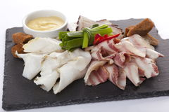 Lard and Bacon on a black plate Stock Photos
