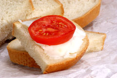 lard on bread with tomato slice Stock Photo