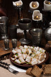 Lard cut into slices with spices. Against the backdrop of a still life of a medieval Stock Image