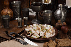 Lard cut into slices with spices. Against the backdrop of a still life of a medieval Royalty Free Stock Images
