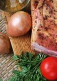 Lard fumé aux oignons et à la tomate Image stock