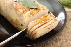 Lard with laurel leaf on a plate. Lard with laurel leaf on a black plate Stock Images