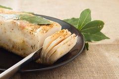 Lard with laurel leaf on a plate. Lard with laurel leaf on a black plate Stock Photography
