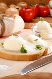 Lard with parsley on home baked bread Stock Image