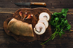 Lard roll with salt and garlic. Wooden background Stock Photos