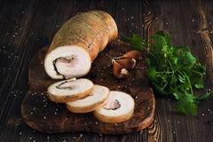 Lard roll with salt and garlic. Wooden background Royalty Free Stock Image