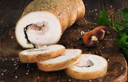 Lard roll with salt and garlic. Wooden background Stock Photo