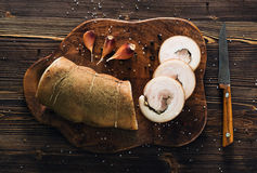 Lard roll with salt and garlic. Wooden background Stock Photography