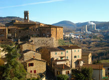 Larderello. Panoramic view of Larderello with geothermal power plant background (Tuscany, Italy Stock Images