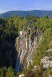Lare waterfalls at Lake Plitvice. Sun shining on Large waterfalls at Lake Plitvice national park in Croatia Royalty Free Stock Images