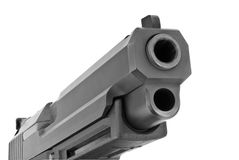 Large 9 mm pistol. Looking down the barrel of a large 9mm automatic pistol Stock Photo