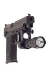 Large 9 mm pistol. Looking down the barrel of a large 9mm automatic pistol with flashlight Stock Photo