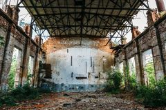 Large abandoned warehouse in Efremov factory, broken brick walls. Rusty interior Royalty Free Stock Photography