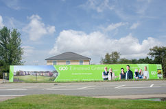 Large advertising hoarding for rural residential development by roadside. Elmstead Essex United Kingdom -17 July 2017: Large advertising hoarding for rural Stock Photos
